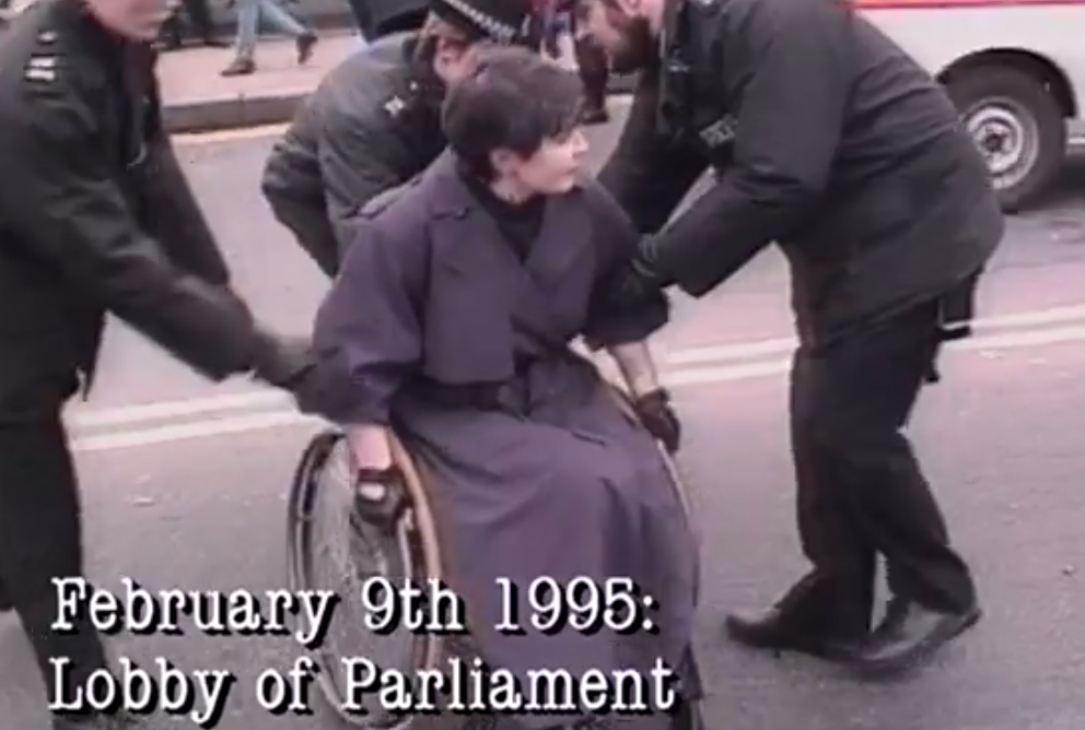 February 9th 1995 lobby of parlimant image - police grabbing someone in a wheelchair.