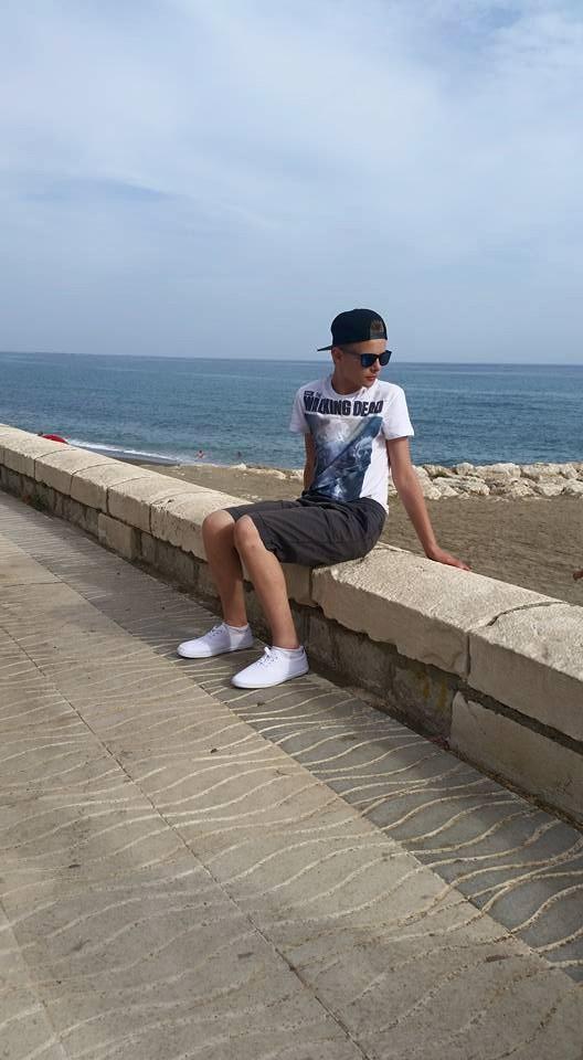 Nathan sat on a wall