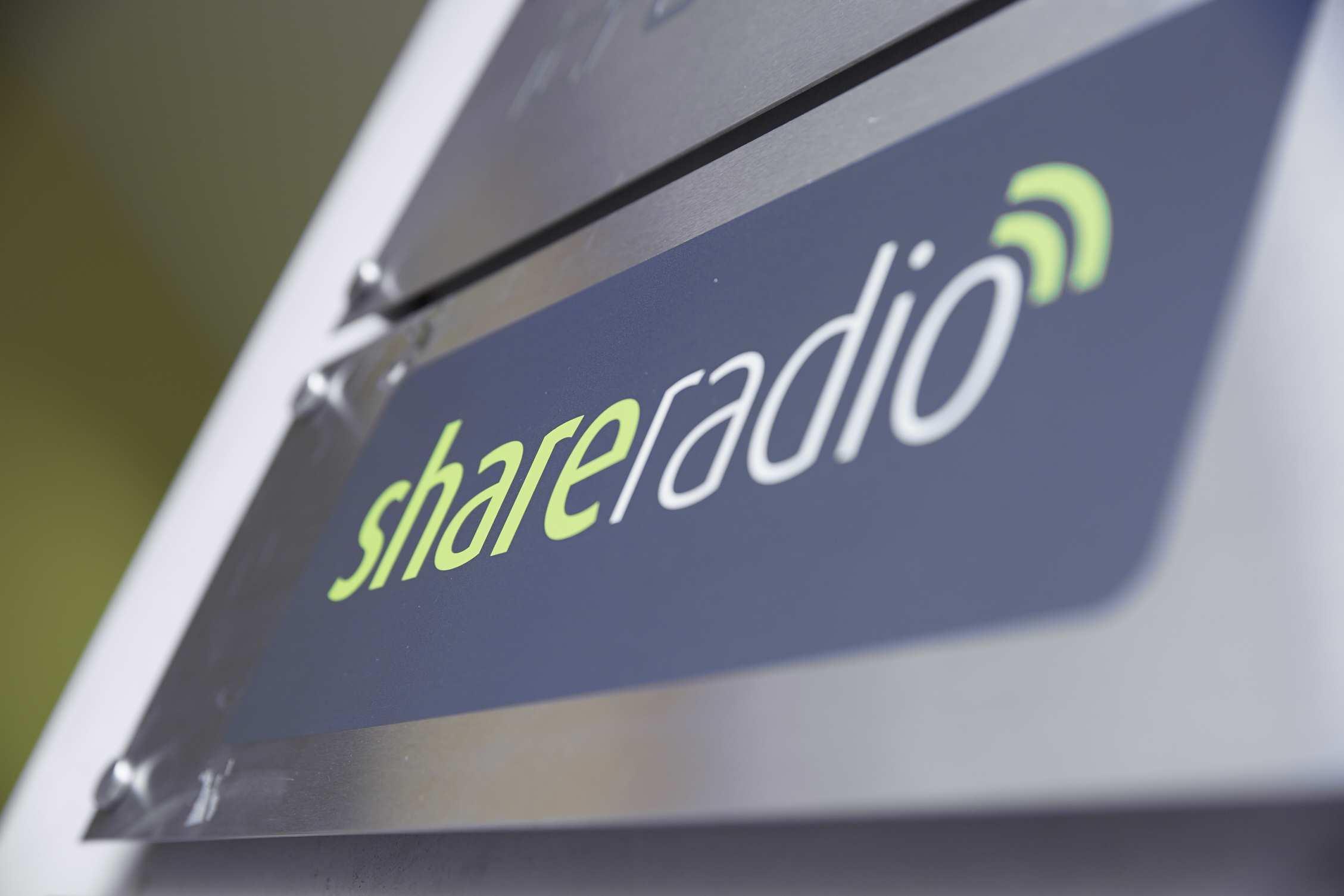 Share Radio logo on a sign