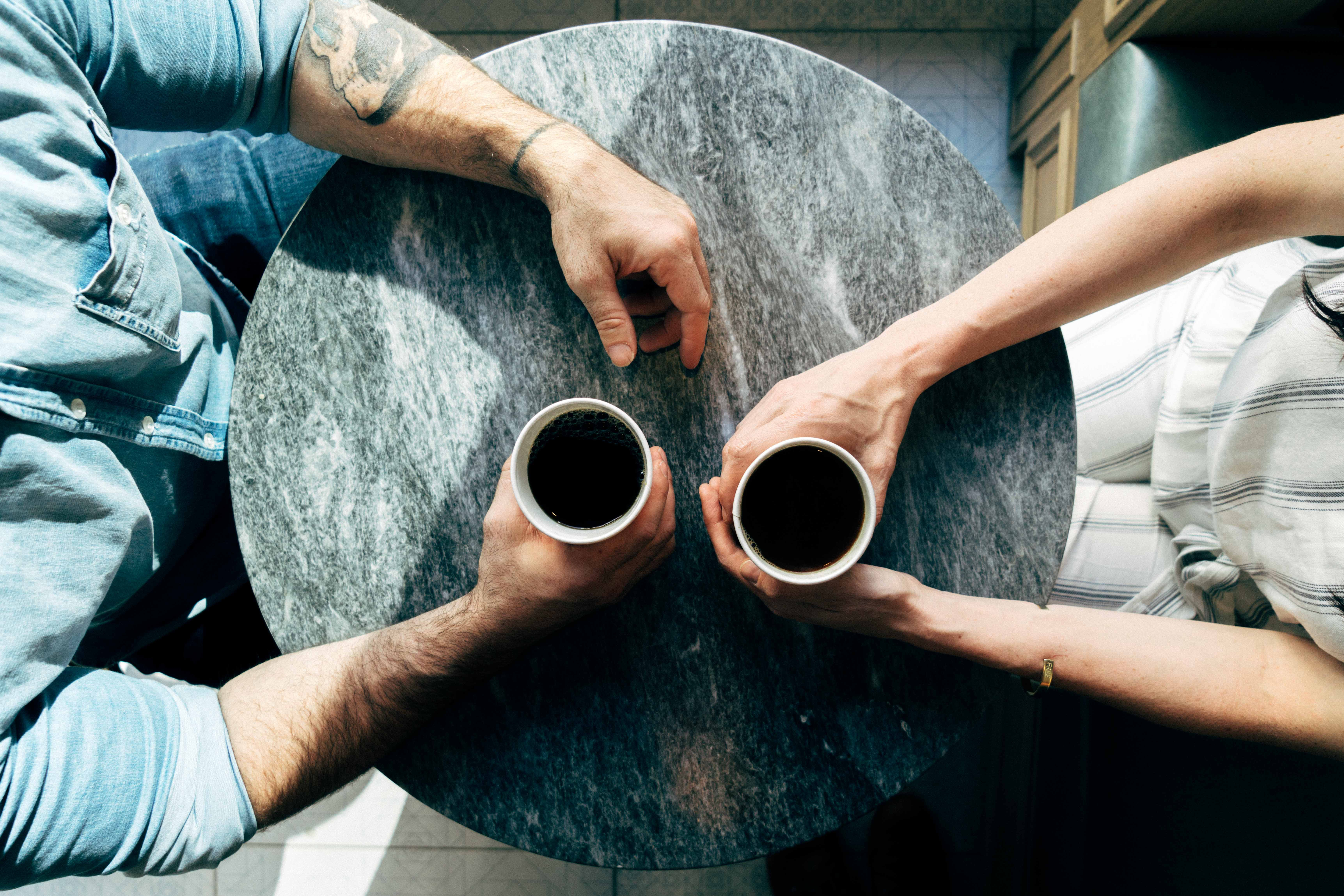 a couple having coffee and talking