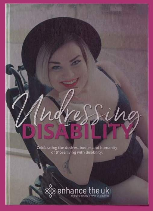 The Undresing Disability front cover, Kelly wearing a black bra, knickers and a hat smiling at the camera with red lipstick. She is sat in her wheelchair.