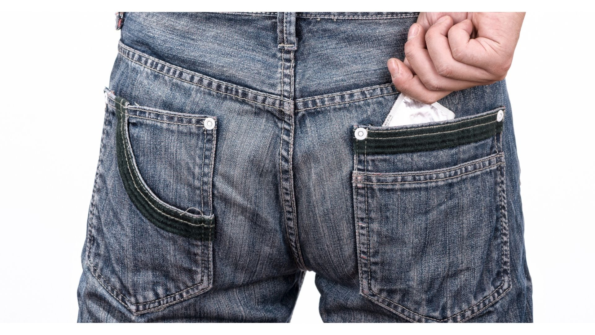 I hate condoms - a rear view of a man wearing jeans with a condom wrapper visible in his back pocket