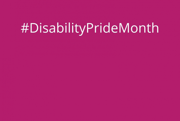 the hashtag Disability Pride Month written in white on a pink background